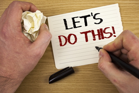 Handwriting text Let Us Do This Motivational Call. Concept meaning Encourage to start something Inspirational Text two words white paper note black marker hand crumbled paper note