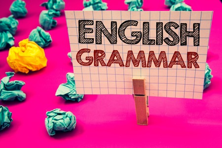 Writing note showing English Grammar. Business photo showcasing Language Knowledge School Education Literature Reading Clothespin hold holding white paper black red letters crumpled papers