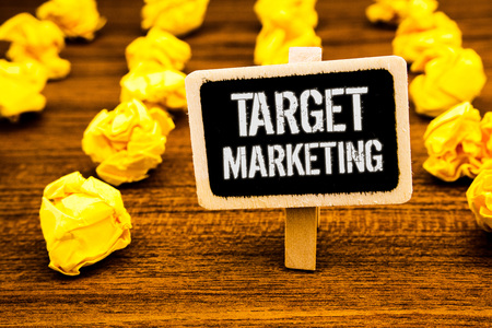 Handwriting text writing Target Marketing. Concept meaning Market Segmentation Audience Targeting Customer Selection White text black paint wooden board clip desk yellow paper notes warning Banque d'images - 104706883