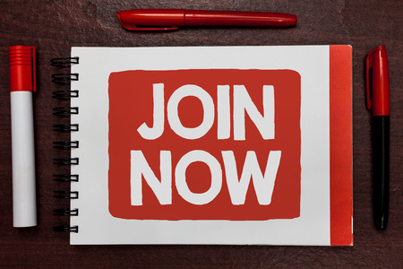 Text sign showing Join Now. Conceptual photo An invite to a person or a friend to become a member of the group Important ideas highlighted notebook markers wooden table reminder message 版權商用圖片