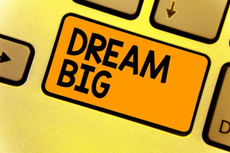 Word writing text Dream Big. Business concept for To think of something high value that you want to achieve Keyboard yellow key Intention create computer computing reflection document Banco de Imagens