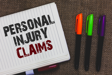 Text sign showing Personal Injury Claims. Conceptual photo being hurt or injured inside work environment Open notebook page jute background colorful markers Expressing ideas