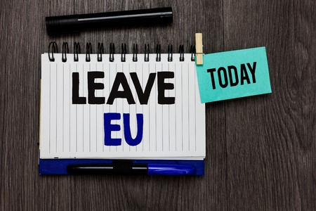 Conceptual hand writing showing Leave Eu. Business photo text An act of a person to leave a country that belongs to Europe Ideas notebook wooden table markers for today important reminder Stock fotó