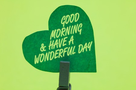 Conceptual hand writing showing Good Morningand Have A Wonderful Day. Business photo showcasing greeting someone in start of the day Clothespin holding green paper heart romantic message ideas