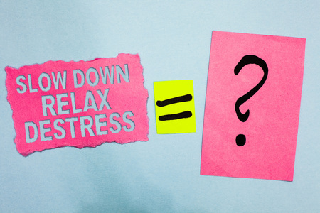 Conceptual hand writing showing Slow Down Relax Destress. Business photo showcasing calming bring happiness and put you in good mood Pink paper equal sign question mark asking important answer Stok Fotoğraf
