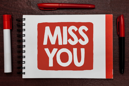 Text sign showing Miss You. Conceptual photo Longing for an important person in your life for a period of time Important ideas highlighted notebook markers wooden table reminder message