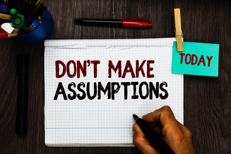 Conceptual hand writing showing Don t not Make Assumptions. Business photo text putting plan in future with percentage happening Register pages handwriting text work stationery items woody table Stock Photo