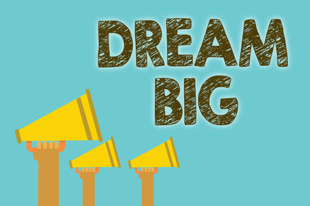 Handwriting text Dream Big. Concept meaning To think of something high value that you want to achieve Megaphones loudspeakers loud screaming scream talk talking speech grunge Stock Photo