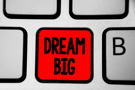 Writing note showing Dream Big. Business photo showcasing To think of something high value that you want to achieve Keyboard red Intention create computer computing reflection document