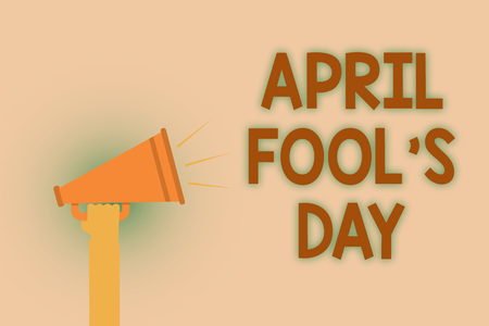 Word writing text April Fool s is Day. Business concept for Practical jokes humor pranks Celebration funny foolish Hand brown loud speaker sound public message hot issue announcement Stock Photo