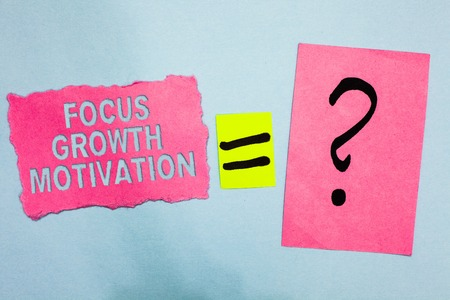 Conceptual hand writing showing Focus Growth Motivation. Business photo showcasing doing something with accuracy increase productivity Pink paper equal sign question mark asking important answer
