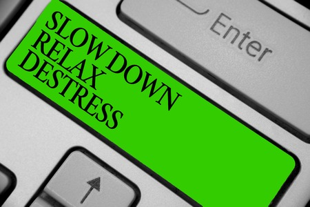 Conceptual hand writing showing Slow Down Relax Destress. Business photo showcasing calming bring happiness and put you in good mood Keyboard green key computer computing reflection document