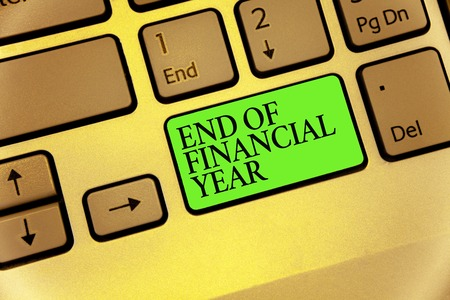 Writing note showing End Of Financial Year. Business photo showcasing Revise and edit accounting sheets from previous year Keyboard button symbol typing job computer use learn program software