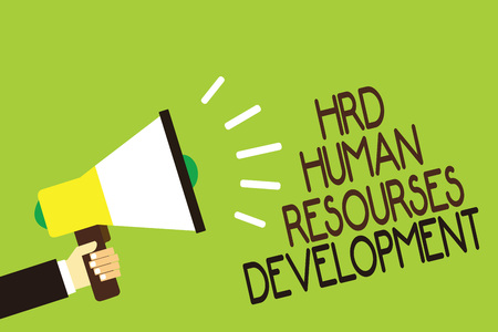 Conceptual hand writing showing Hrd Human Resources Development. Business photo showcasing helping employees develop personal skills Man holding megaphone green background message speaking loud Stock Photo