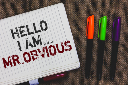 Text sign showing Hello I Am.. Mr.Obvious. Conceptual photo introducing yourself as pouplar or famous person Open notebook page jute background colorful markers Expressing ideas Banco de Imagens