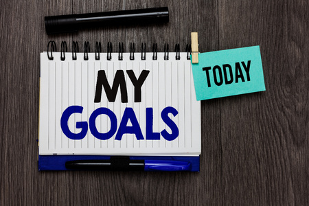 Conceptual hand writing showing My Goals. Business photo text Future or desired result that a person commits to achieve Ideas notebook wooden table markers for today important reminder