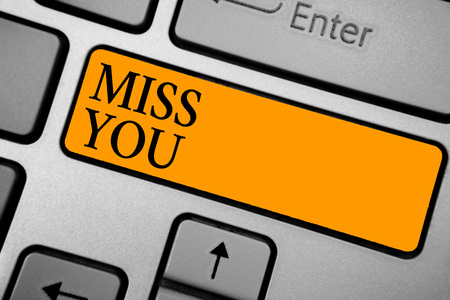Text sign showing Miss You. Conceptual photo Longing for an important person in your life for a period of time Keyboard orange key Intention create computer computing reflection document