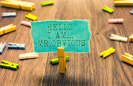 Word writing text Hello I Am.. Mr.Obvious. Business concept for introducing yourself as pouplar or famous person Clothespin holding turquoise paper note several clothespins wooden floor