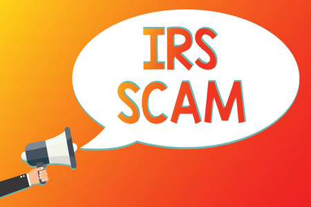 Writing note showing Irs Scam. Business photo showcasing targeted taxpayers by pretending to be Internal Revenue Service Megaphone loudspeaker screaming scream idea talk talking speech listen Stock Photo