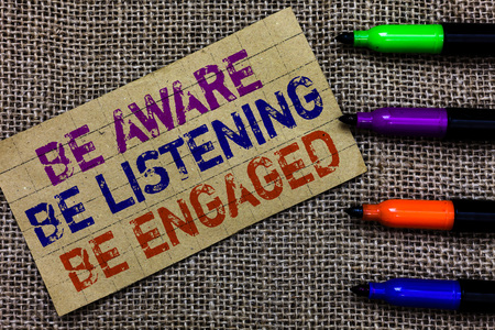 Handwriting text writing Be Aware Be Listening Be Engaged. Concept meaning take attention to actions or speakers Paperboard computer mouse jute background Expressing ideas typing needs