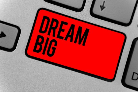 Text sign showing Dream Big. Conceptual photo To think of something high value that you want to achieve Keyboard red key Intention create computer computing reflection document