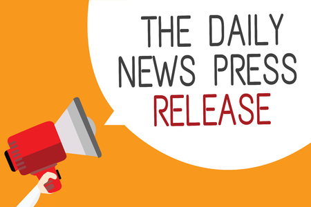 Text sign showing The Daily News Press Release. Conceptual photo announcing big news or speak to people Man holding megaphone loudspeaker speech bubble message orange background Stock Photo