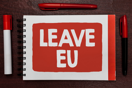 Text sign showing Leave Eu. Conceptual photo An act of a person to leave a country that belongs to Europe Important ideas highlighted notebook markers wooden table reminder message