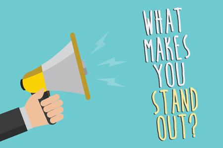Text sign showing What Makes You Stand Out question. Conceptual photo asking someone about his qualities Man holding megaphone loudspeaker blue background message speaking loud Stock Photo