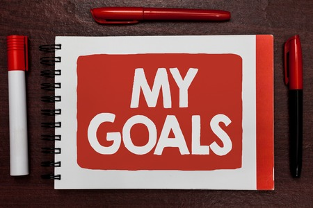Text sign showing My Goals. Conceptual photo Future or desired result that a person commits to achieve Important ideas highlighted notebook markers wooden table reminder message