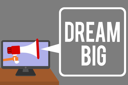 Conceptual hand writing showing Dream Big. Business photo showcasing To think of something high value that you want to achieve Man holding Megaphone computer screen talking speech bubble Banco de Imagens