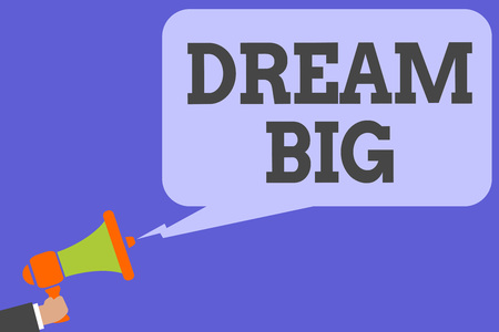 Writing note showing Dream Big. Business photo showcasing To think of something high value that you want to achieve Man hold Megaphone loudspeaker computer screen talking speech bubble Banco de Imagens