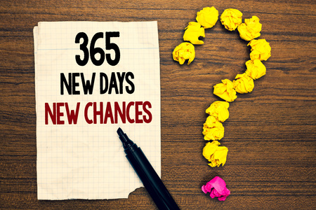 Word writing text 365 New Days New Chances. Business concept for Starting another year Calendar Opportunities Written torn page touch black pen yellow paper lob form question on woody deck