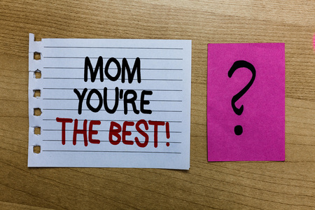 Conceptual hand writing showing Mom You re are The Best. Business photo text Appreciation for your mother love feelings compliment white page on wooden desk with words violet with question mark