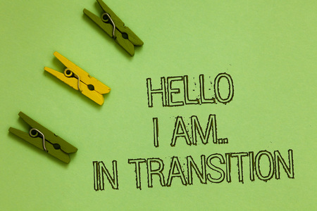 Word writing text Hello I Am.. In Transition. Business concept for Changing process Progressing planning new things Outline words green middle yellow paper clip on olive color ground Stok Fotoğraf