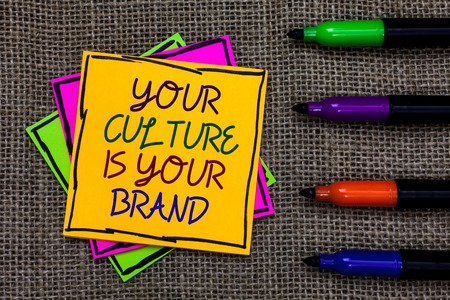 Text sign showing Your Culture Is Your Brand. Conceptual photo Knowledge Experiences are a presentation card Written on some colorful sticky note 4 pens laid in rank on jute base