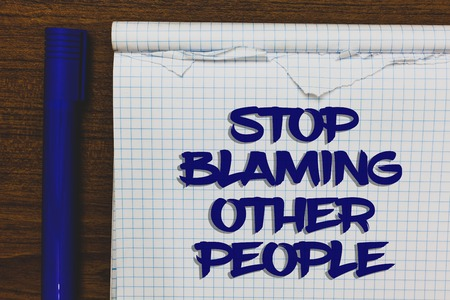 Writing note showing Stop Blaming Other People. Business photo showcasing Do not make excuses assume your faults guilt Written white notepad on grey wooden background beside blue marker