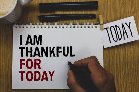 Conceptual hand writing showing I Am Thankful For Today. Business photo text Grateful about living one more day Philosophy Written on paper hand hold pen clipper grip sticky note black pen Stock Photo