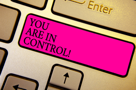 Handwriting text You Are In Control. Concept meaning Responsibility over a situation Management authority Crystal orange computer keyboard pink button written texts enter word Foto de archivo