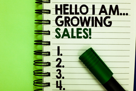 Handwriting text Hello I Am... Growing Sales. Concept meaning Making more money Selling larger quantities Written letters and numbers on notepad laid green marker green back