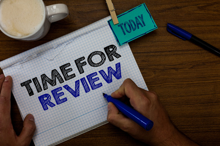 Writing note showing Time For Review. Business photo showcasing Evaluation Feedback Moment Performance Rate Assess Hand hold pen coffee cup blue pen paper clip stick on woody table