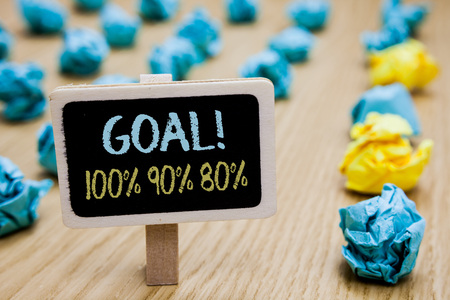 Conceptual hand writing showing Goal 100 90 80. Business photo text Percentage of your objectives fulfilment success level poster board with blurry paper lobs laid serially mid yellow lob