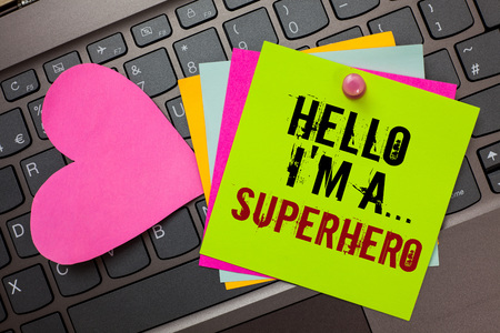 Text sign showing Hello I am A ... Superhero. Conceptual photo Special powers Cartoon character Customs strenght Bright colorful written papers pinch by pin pink heart on computer keyboard