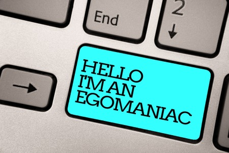 Text sign showing Hello I am An Egomaniac. Conceptual photo Selfish Egocentric Narcissist Self-centered Ego Silver grey computer keyboard with blue button black color written text 스톡 콘텐츠