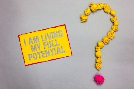 Writing note showing I Am Living My Full Potential. Business photo showcasing Embracing opportunities using skills abilities Red bordered yellow sticky note yellow paper lumps form question mark