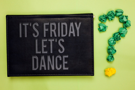 Word writing text It s is Friday Let s is Dance. Business concept for Celebrate starting the weekend Go party Disco Music Green back black plank with text green paper lob form question mark