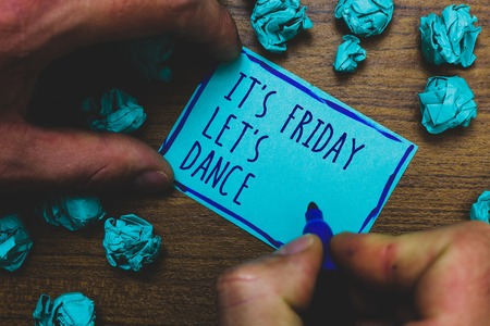 Writing note showing It s is Friday Let s is Dance. Business photo showcasing Celebrate starting the weekend Go party Disco Music Foggy hand hold marker drawn blue notepad paper lump on wooden floor