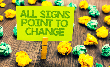 Handwriting text All Signs Point To Change. Concept meaning Necessity of doing things differently new vision Paperclip retain written words yellow paper paper lobs laid on wooden floor Stock Photo