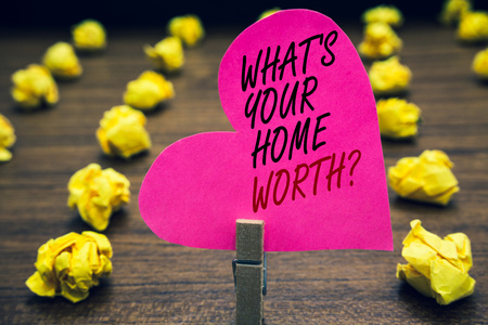 Conceptual hand writing showing What s is Your Home Worth question. Business photo text Value of a house Property Cost Price Rate Paperclip hold pink written heart woody floor with yellow lobs Stock fotó