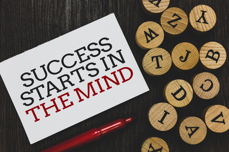 Text sign showing Success Starts In The Mind. Conceptual photo Have positive thoughts accomplish what you want Written paper red marker beside round woody alphabets on wooden base Фото со стока