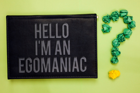 Word writing text Hello I am An Egomaniac. Business concept for Selfish Egocentric Narcissist Self-centered Ego Green back black plank with text green paper lob form question mark